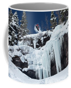 A Snowboarder Jumps Off An Ice Coffee Mug