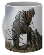 A Soldier Communicates Using A Coffee Mug