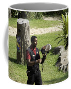 A Trainer And A Large Bird Of Prey At A Show Inside The Jurong Bird Park Coffee Mug