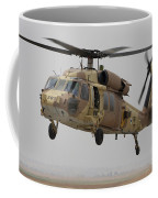 A Uh-60l Yanshuf Helicopter Landing Coffee Mug