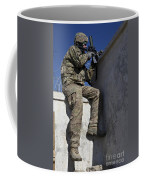 A U.s. Soldier Provides Security At An Coffee Mug
