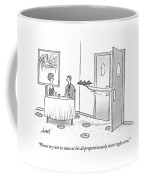 A Waiter Serves A Couple With His Long Coffee Mug