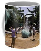 A Water Fountain With Dinosaur Eggs In Universal Studios Singapore Coffee Mug
