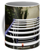 A White Plastic Stand For Hanging And Drying Clothes Coffee Mug
