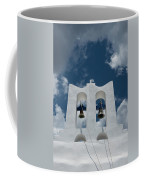 A Whitewashed Bell Tower And Dramatic Coffee Mug