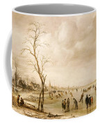 A Winter Landscape With Townsfolk Skating And Playing Kolf On A Frozen River Coffee Mug by Aert van der Neer
