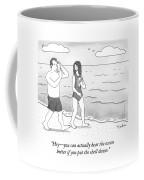 A Woman And Man Walk On A Beach Coffee Mug