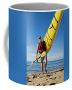 A Woman Carrying Her Sea Kayak Coffee Mug