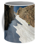 A Woman Descending A Snow Slope While Coffee Mug