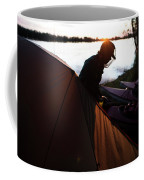 A Woman Exits The Tent At Sunset Coffee Mug