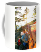 A Woman Is Resting In A Tent On One Coffee Mug