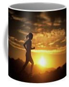 A Woman Jogs Under Sunset Coffee Mug