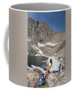 A Woman Looks Across A Partially Frozen Coffee Mug