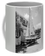 A Woman On Sailboat At Home Coffee Mug