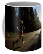 A Woman Running On A Country Road Coffee Mug