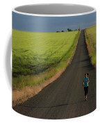 A Woman Running On A Dirt Road Coffee Mug