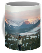 A Woman Stands Against A Snowy Mountain Coffee Mug