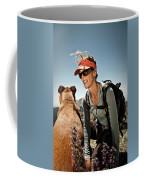 A Woman  Talks To Her Dog While Taking Coffee Mug