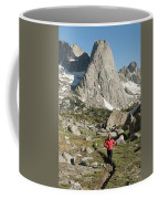 A Woman Trail Running In The Cirque Coffee Mug