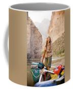 A Woman Unloads Gear From Her Canoe Coffee Mug