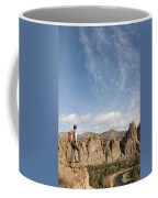 A Woman With A Day Pack Overlooking Coffee Mug