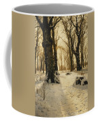 A Wooded Winter Landscape With Deer Coffee Mug by Peder Monsted