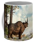 A Woolly Rhinoceros Trudges Coffee Mug by Daniel Eskridge
