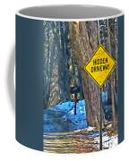 A Yellow Diamond Sign With The Words Hidden Driveway On The Side  Coffee Mug