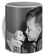 A Young Boy Is Face To Face With A Puppy Tongue. Coffee Mug