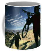 A Young Couple Carry Their Mountain Coffee Mug