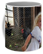 A Young Girl Shows Off Her Familys Coffee Mug