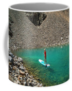 A Young Male Paddleboarding On A Small Coffee Mug