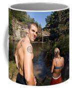 A Young Man And Woman Pause Coffee Mug