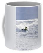 A Young Man Falls While Skiing Coffee Mug