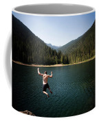 A Young Man Jumps From A Ledge Coffee Mug