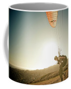 A Young Man Launches His Paraglider Coffee Mug