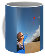 A Young Man Looks Up At His Red Kite Coffee Mug