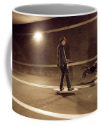 A Young Man On A Skateboard Is Pulled Coffee Mug