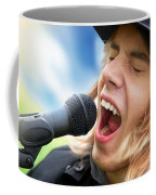 A Young Man Sings To A Microphone Coffee Mug