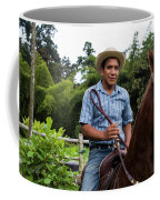 A Young Man Sits On A Horse And Smiles Coffee Mug