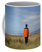 A Young Man Stands In A Field Coffee Mug