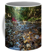 A Young Man Watches A Shallow River Coffee Mug