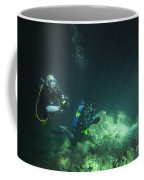 A Young Married Couple Scuba Diving Coffee Mug by Michael Wood