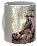 A Young Rock Climber Puts On A Climbing Coffee Mug