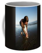 A Young Woman Collects Seashells Coffee Mug