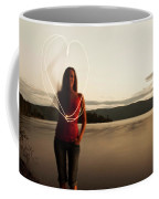 A Young Woman Drawing A Heart At Sunset Coffee Mug