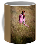 A Young Woman Sitting In A Field Coffee Mug