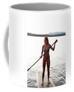 A Young Woman Smiles While Stand Coffee Mug