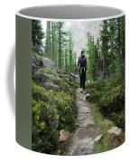 A Young Woman Walks Along An Sub-alpine Coffee Mug