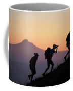 Adventure Racing Team Hiking At Sunset Coffee Mug